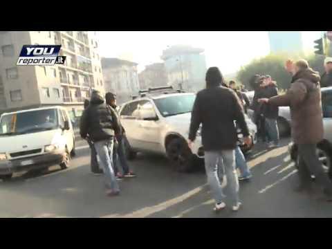 Ajax-hooligans rellen in Milaan